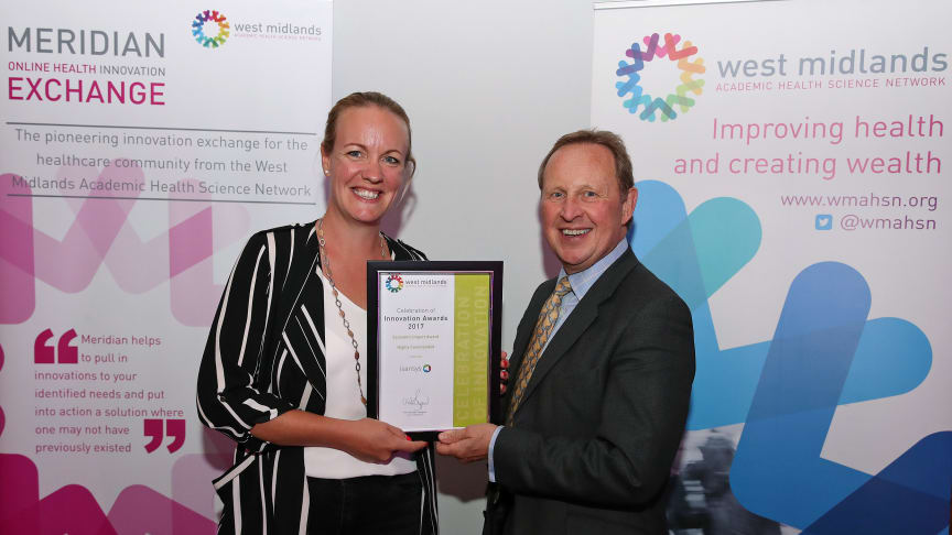 Georgina Horton, PR and Marketing Executive at Isansys, collecting the award at the Celebration of Innovation Awards 2017