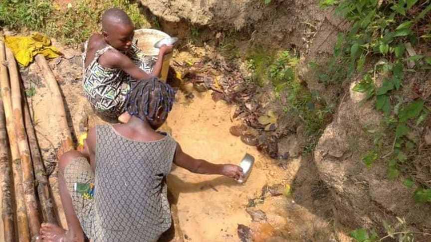 Two girls collecting water in Enugu State