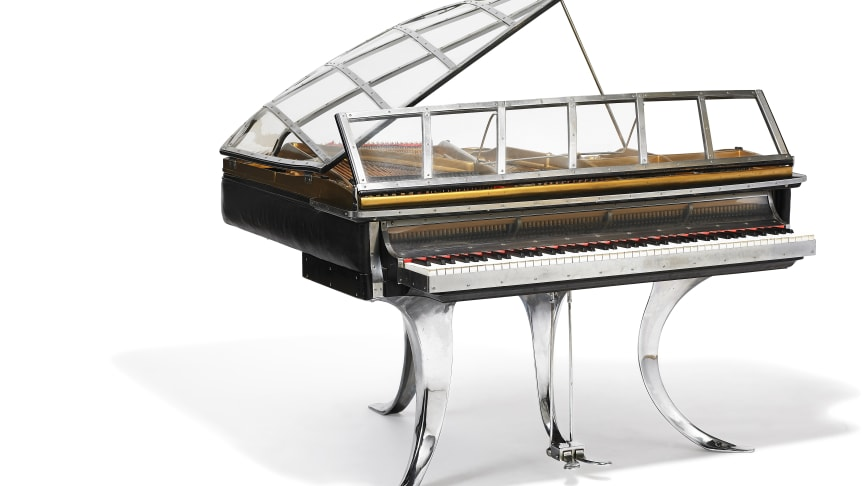 """Poul Henningsen: """"PH Grand Piano"""". Black stained wood, chrome steel and edge covered with black leather. Sold for: DKK 2,450,000 (EUR 430,000 including buyer's premium)."""