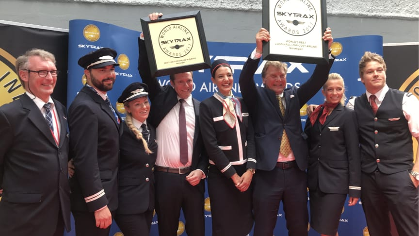Norwegian's Chief Commercial Officer, Thomas Ramdahl, the Chairman of Norwegian's Board, Bjørn Kise, and crew members celebrate the Skytrax awards today at 2017 Paris Air Show