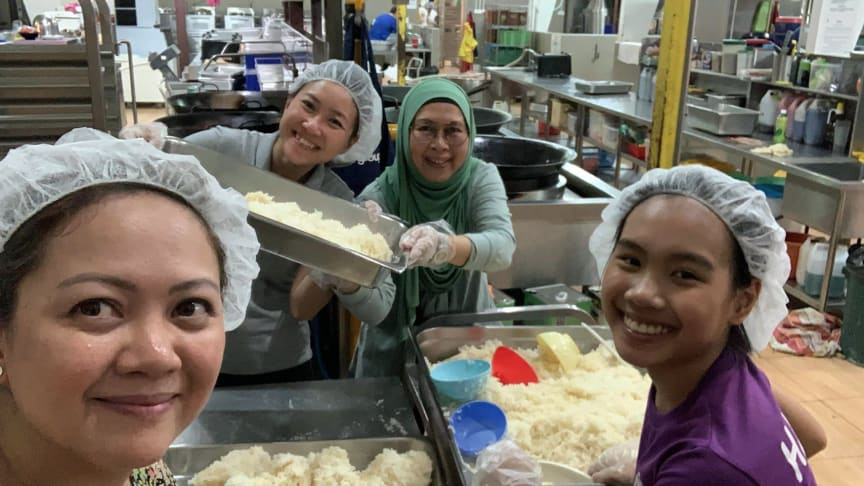 Volunteers at Willing Hearts Soup Kitchen, Singapore.