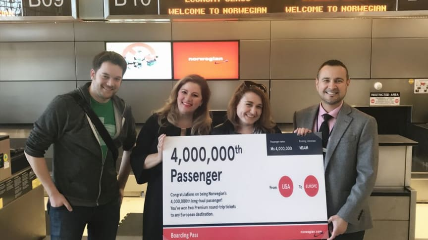 Debra Burnill, second from right, received a pair of round-trip premium tickets to any long-haul destination within Norwegian's network