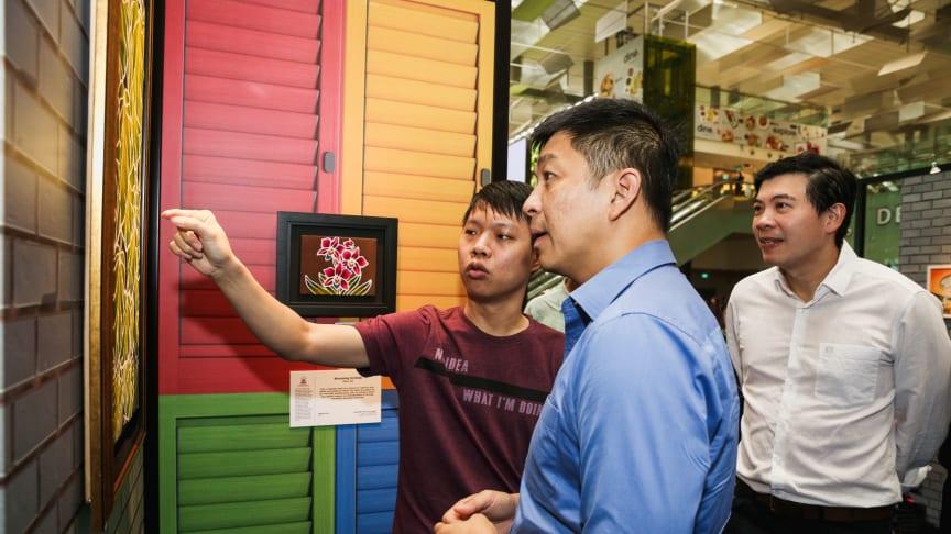 Seah Chee Meng, resident artist at Metta Welfare Association, Speaker Tan Chuan-Jin and CAG CEO Lee Seow Hiang at the inaugural Changi Inspires Art Fair