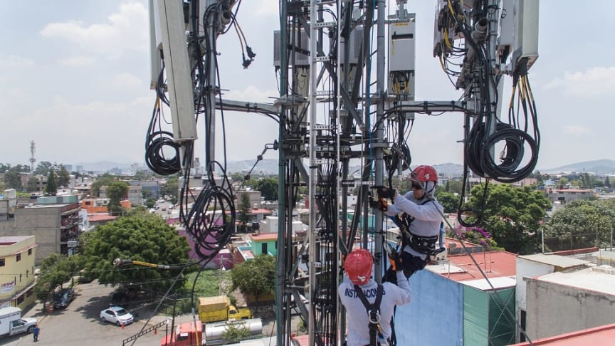 Two Panalpina technicians install telecoms equipment for a mobile network antenna in Mexico. (Photo from Panalpina)
