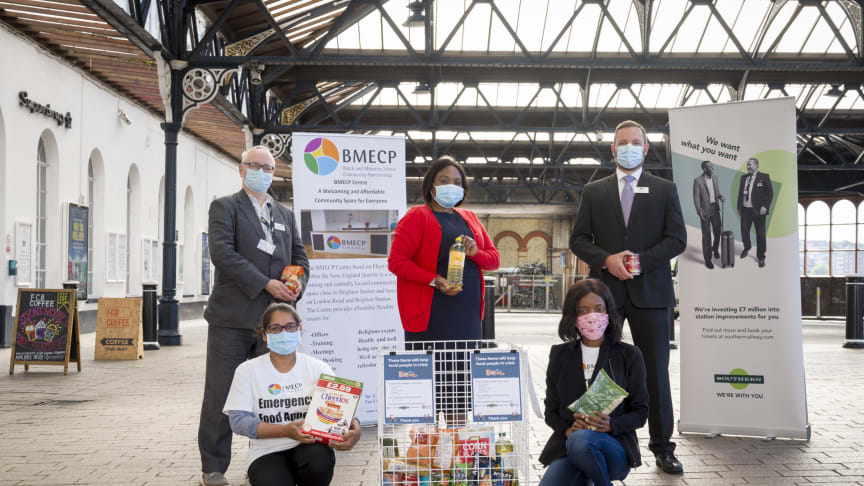 Juliet Ssekitoleko (Brighton BMECP Foodbank) with Andy Leister (Southern), Rob Whitehead (GTR) and volunteers. MORE IMAGES AVAILABLE TO DOWNLOAD BELOW
