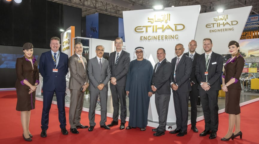 Delegates from Etihad Engineering and Satair gather at Dubai Airshow after the contract signing.