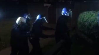 [Officers entering one of the addresses in New Addington]