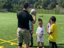 Police host summer camp for children at Harrow School