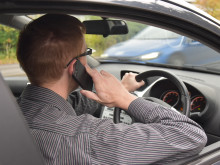 A fifth of firms say drivers in accidents due to using handheld phones at the wheel