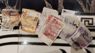 [Image of recovered money]