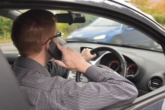 Driver using a mobile phone at the wheel