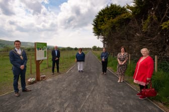 Former Mayor Cllr Peter Johnston with local  representatives at the new community Greenway in Glenravel