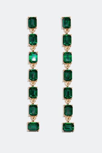 Guldfarvede øreringe med grønne sten
