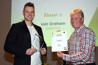 Driver of the Year winner - Paul Coyle collects on behalf of Iain Graham from managing director Kevin Carr