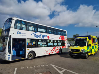 Go North East's 'thank you' bus with a freshly cleaned ambulance