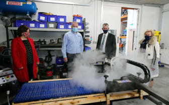 MEA LAG Chair Kelli McRoberts, Vice Chair Ald Audrey Wales and DEARA Minister Edwin Poots were given a demonstration by Managing Director William Carey of Carey Cleaning Machines