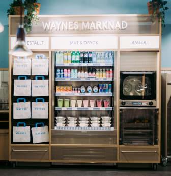 Waynes nya koncept innefattar en del med mat och dryck som man enkelt kan ta med sig.