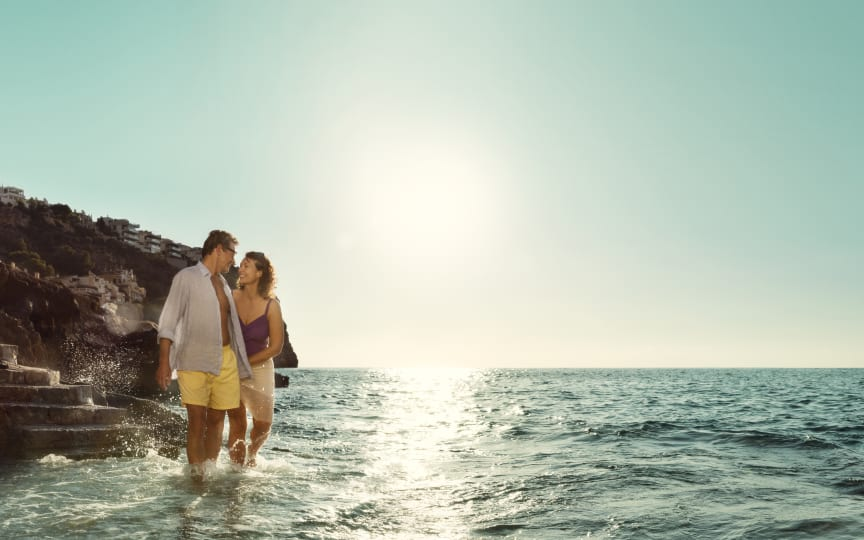 Gå tur langs stranden