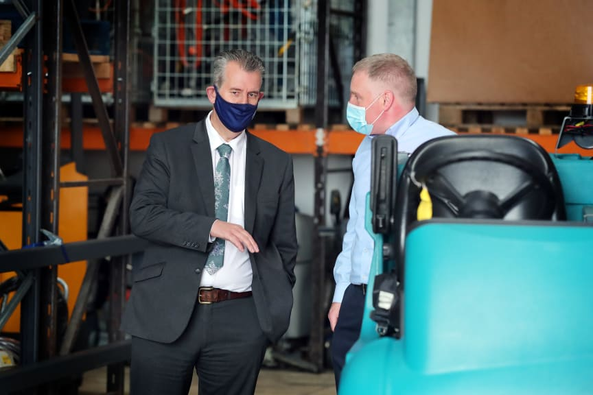 DAERA Minister Edwin Poots being given a tour of Carey Cleaning Machines by Managing Director, William Carey