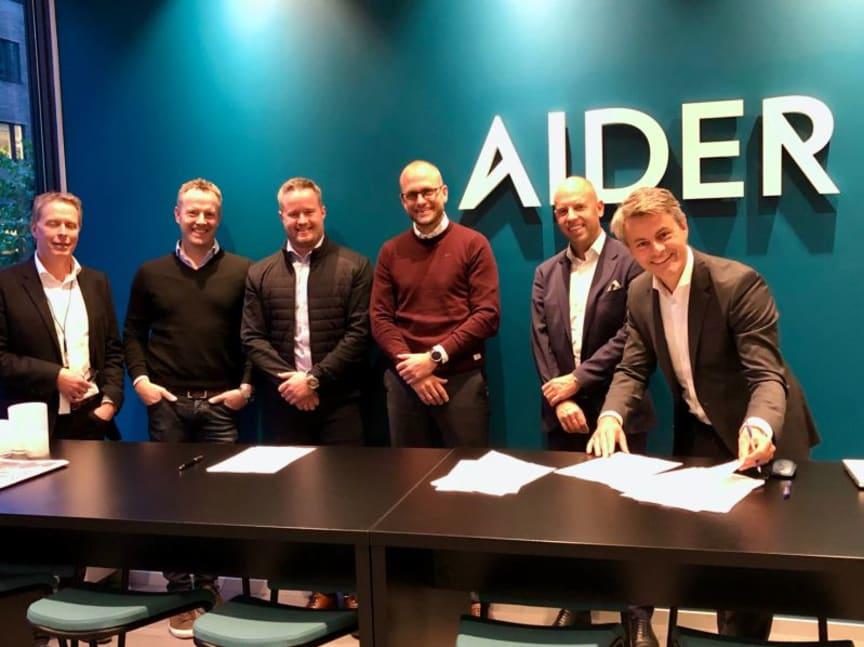 Aider og R8 Consulting signerer avtale.jpeg