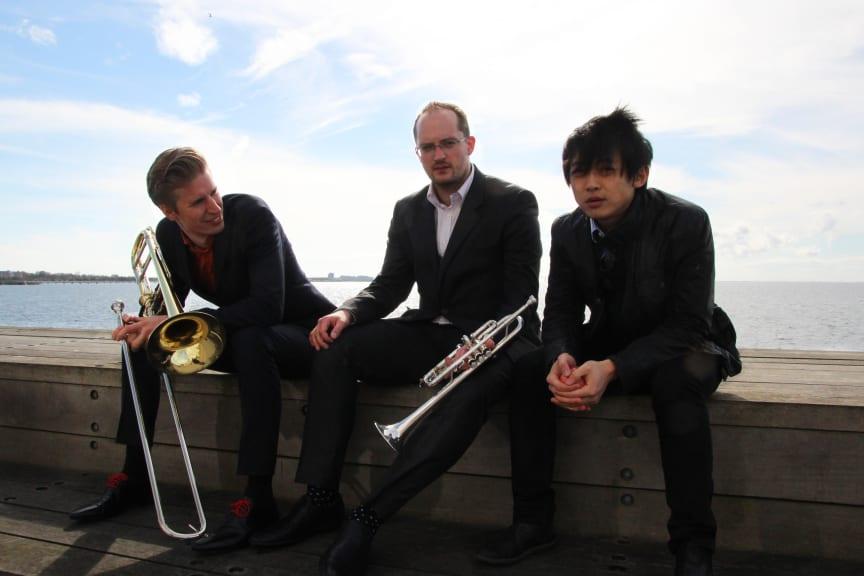 Trio Huang-Draglund-Rudolfsson