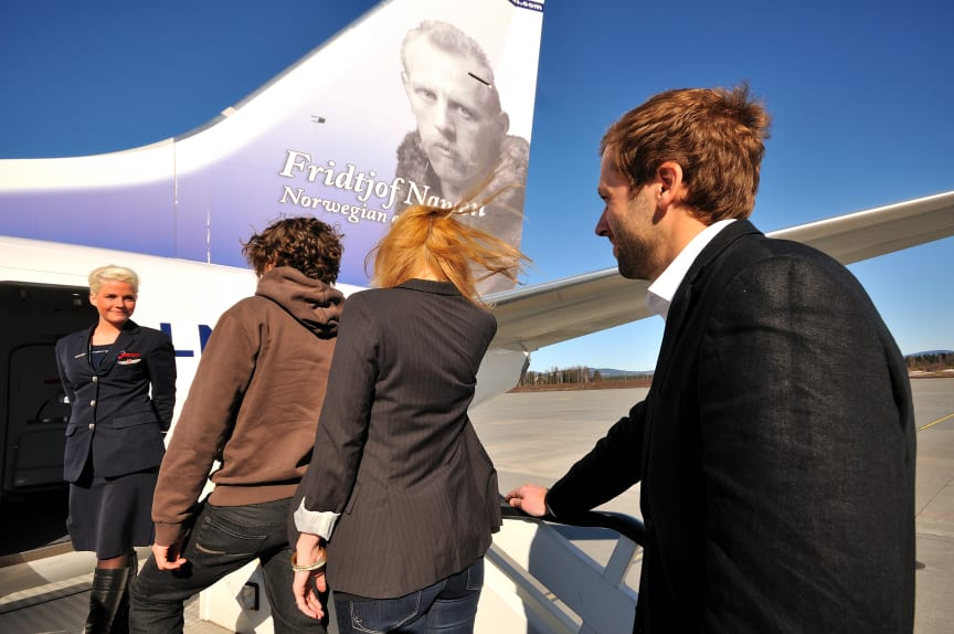 Passengers entering a Norwegian flight