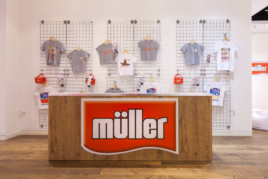 Merchandise stand at the Müller Corner Shop