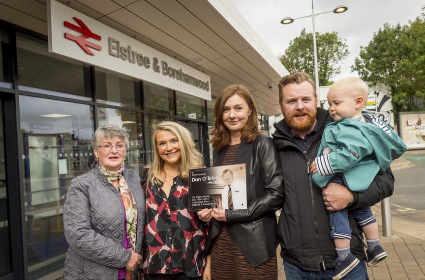 Members of Don O'Brien's family with the memorial plaque Thameslink is placing in the station concourse