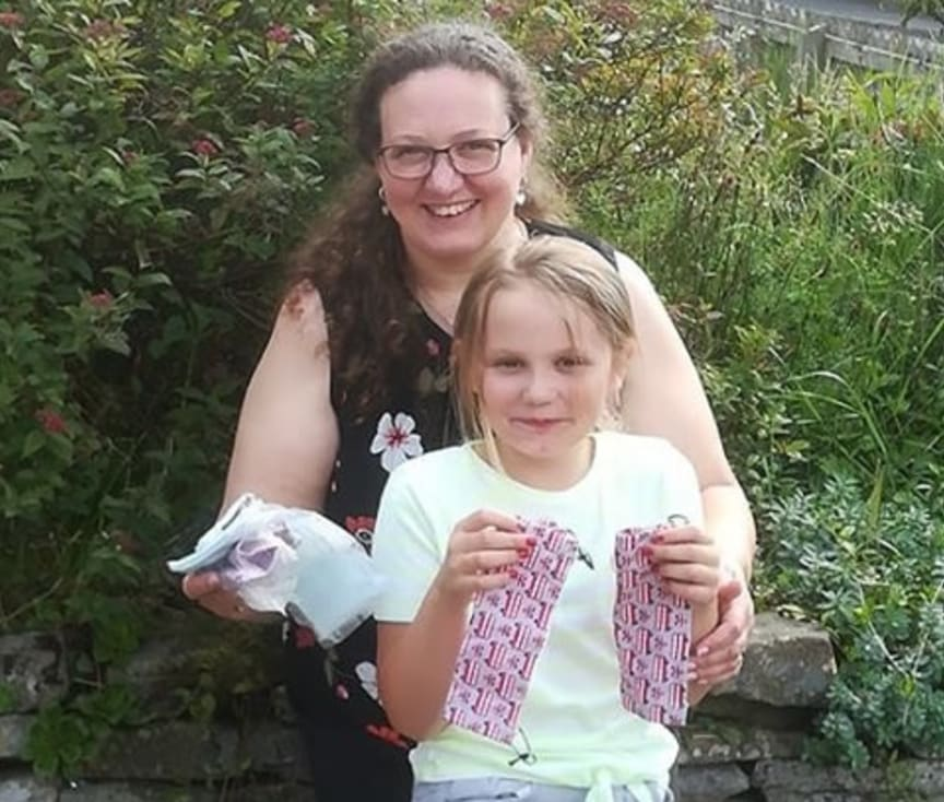Lynn and daughter Izzy, who have been making face coverings to help protect colleagues and customers