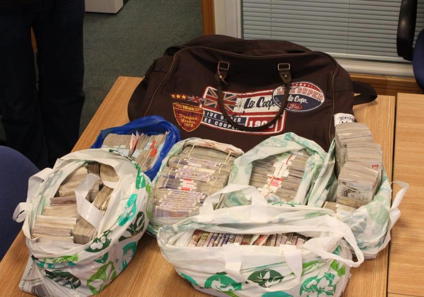 £15m fraud gang jailed - £159,990 of the cash seized