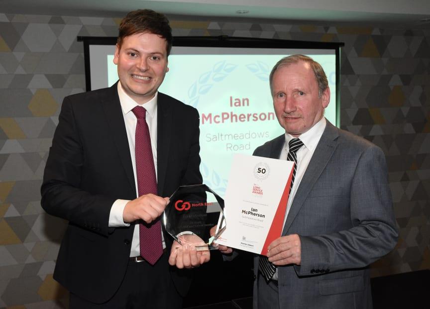 Martijn Gilbert (Managing Director)  presenting Ian McPherson with his award