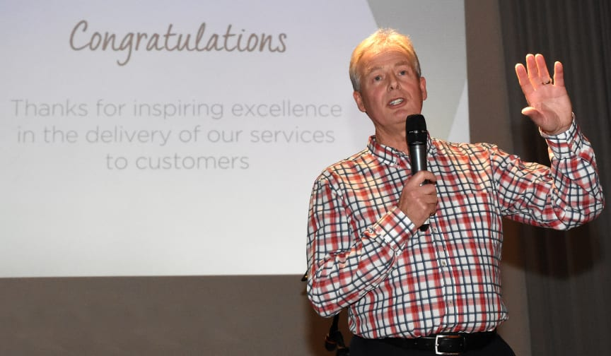Managing director Kevin Carr congratulates go North East team members for inspiring excellence