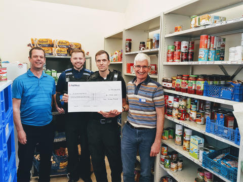 Police give donation to Brighton Food Bank