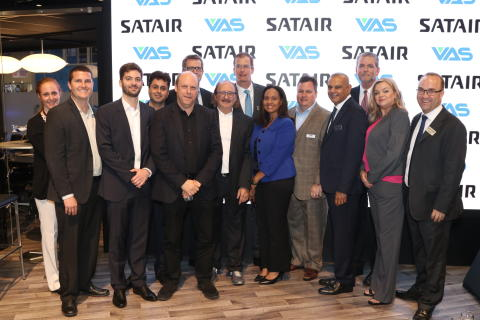 Group photo after the signing ceremony at the Satair booth.