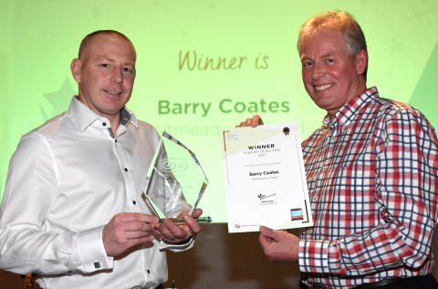 Engineer of the Year winner -  Michael Langwell collects on behalf of Barry Coates from Kevin Carr