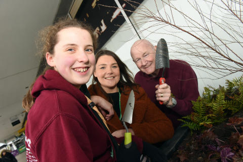 Great Linford Scouts, railway staff and volunteers fill planters at Milton Keynes station