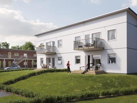 Illustration av trädgårdssida med altan/balkong och gräsytor, BoKlok Solbacka.