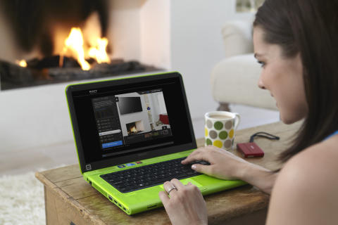 A woman sat at her laptop using the TV suide size tool