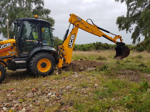 An illegal development next to a nature reserve was taken down by council enforcement staff yesterday