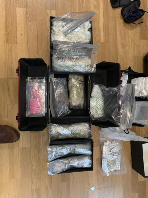 Two firearms and £100,000 in cash seized after raids in west London