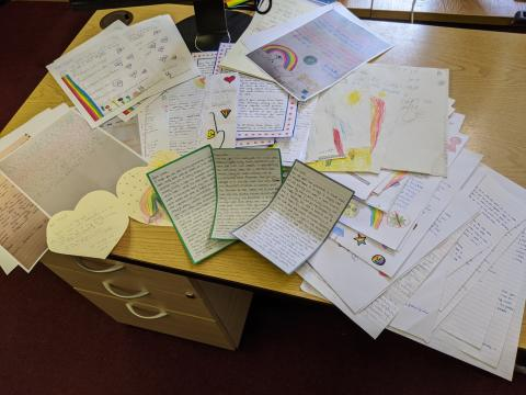 Children and young people are 'posting positivity' with letters to those who are isolated