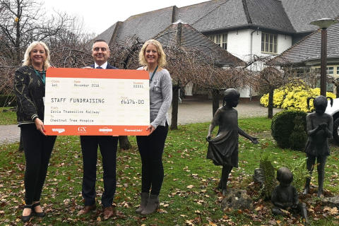GTR HR Director Andy Bindon presents a staff donation to Mikayla Bernstein (left) and Alison Taylor of Chestnut Tree House children%27s hospice