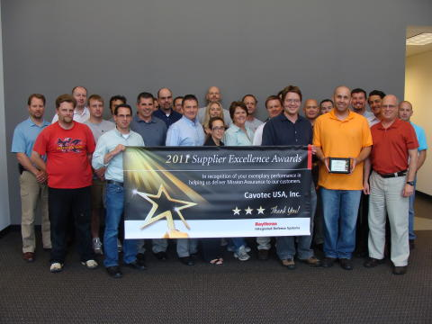 The Cavotec USA Inc. team with their Raytheon Supplier Excellence award banner
