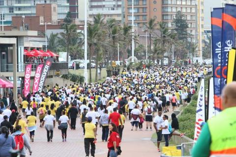 Walkers stream along the Durban promenade
