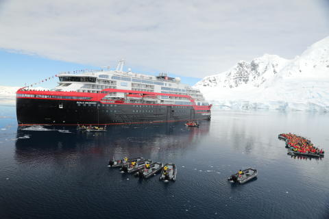 Named in ice - with ice: Battery hybrid powered cruise ship becomes first vessel named in Antarctica