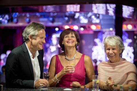 Friends enjoying drinks in the Neptune Lounge