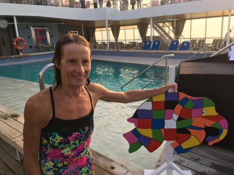 World record-holding swimmer boosts funds for Elmer's Big Parade Suffolk in pool challenge during Black Watch World Cruise with Fred. Olsen