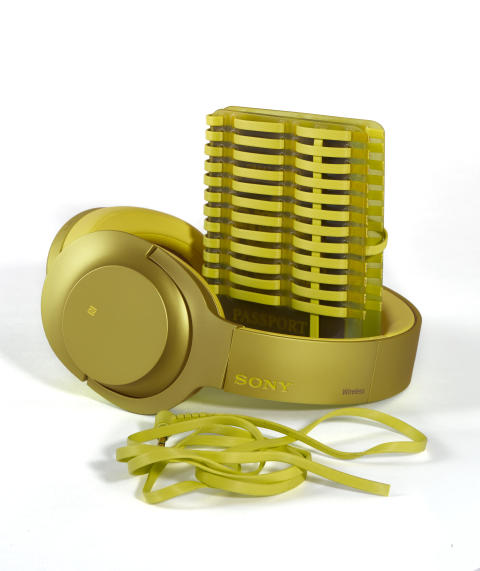 sony h.ear on yellow headphones with passport holder