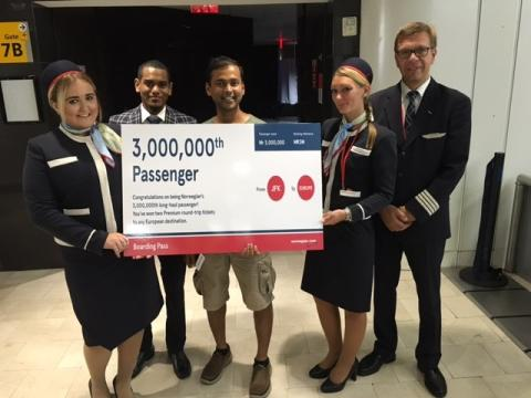 3,000,000th US Long-Haul Passenger, Naresh Airody (center), with Members of the JFK-LGW Crew