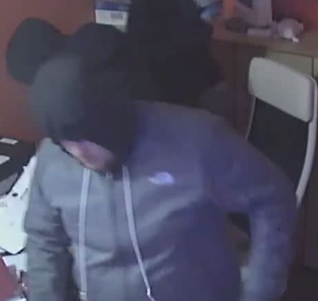 CCTV image of a man officers would like to speak to in relation to a burglary in Bletchley